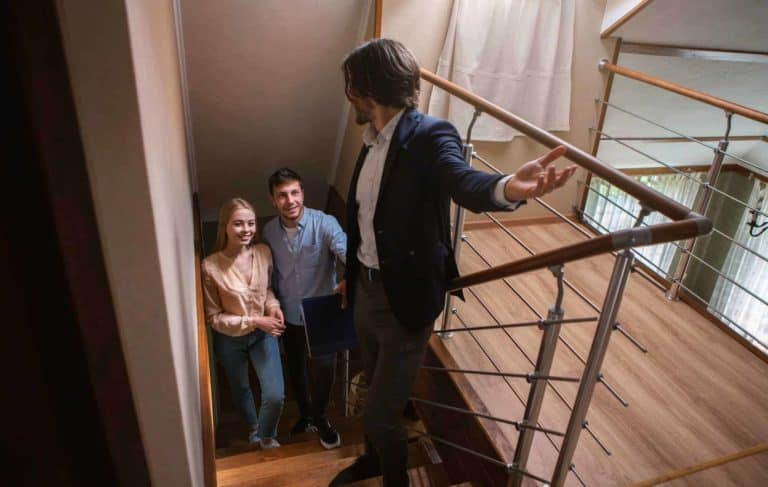 Real estate agent showing prospective buyers around property